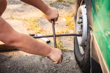 Fixing car tire with rim socket wrench