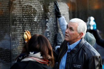 Vice President Mike Pence participates in a volunteer service event cleaning the wall at the Vietnam Veterans Memorial in Washington
