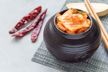 Kimchi cabbage. Korean appetizer in ceramic jar, horizontal