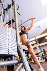 A young girl performing weight lifting in the Gym