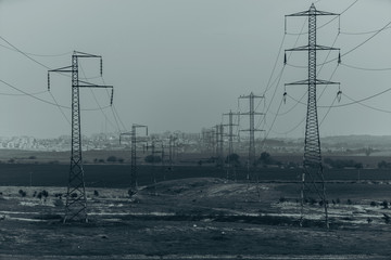 high voltage poles with wires