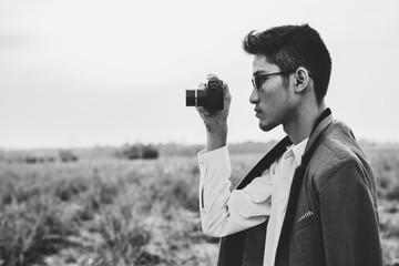A man holding camera to a shot.