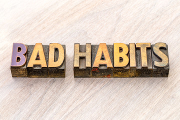 bad habits word abstract in wood type