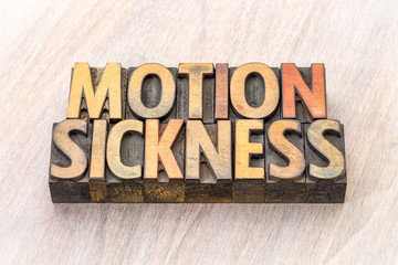 motion sickness word abstract in wood type