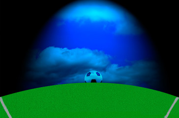 Soccer field with a ball under a blue sky with