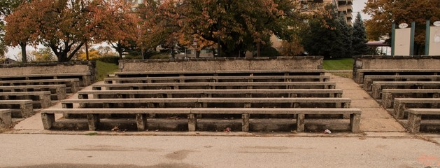 Old stone bleachers in a park setting