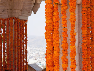 Hanging marigold flower decorations at a Hindu wedding celebration in Rajasthan, India