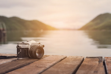 Retro camera with beautiful landscape