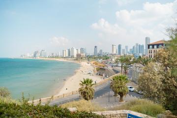 Viev on the beach and urban city Tel-Aviv. Summer coastline. Famous tourist place