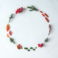 Christmas round frame made of natural winter and autumn things. Flat lay. Holiday concept.