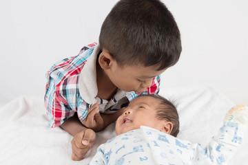 Cute asian boy kiss baby