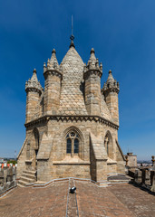 Tower of the Se Cathedral in Evora, Portugal. The spire of the cathedral's tower is surrounded by six turrets, and each turret is a miniature copy of the tower itself.