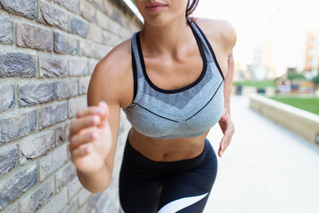 Beautiful athletic woman running outdoors.