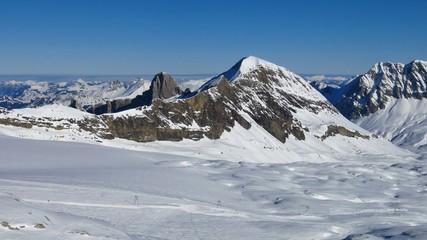 View from the Diablerets glacier ski area. Winter scene in the Swiss Alps.