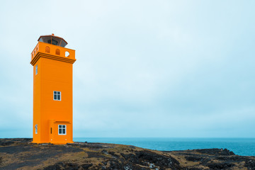 Teal and orange mood of Saxholsbjarg lighthouse in Iceland