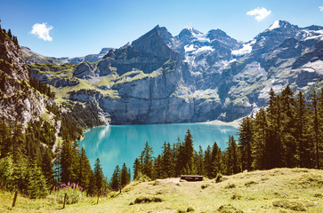 Panorama of the azure lake Oeschinensee. Swiss alps, Kandersteg.