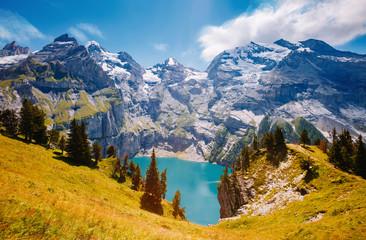 Panorama of the azure lake Oeschinensee. Swiss alps, Kandersteg.