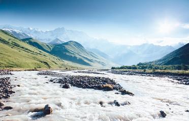 Rapid river at the foot of the glacier Shkhara. Location Svaneti, Georgia.