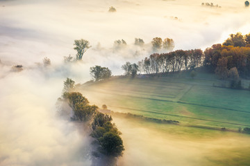 View of the Adda river valley during a foggy morning, Airuno, Italy