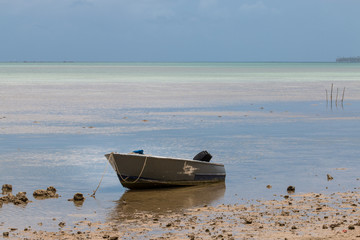 Old wooden boat on shallow water-1