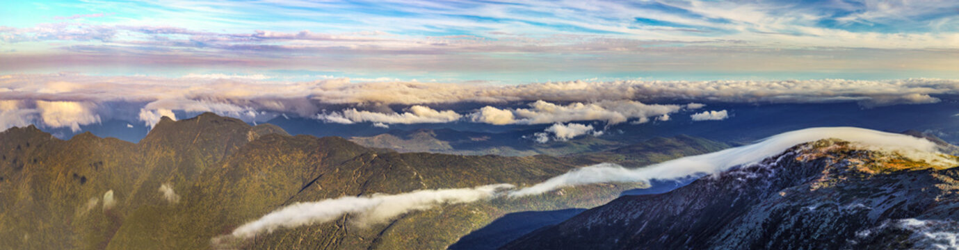 view from Mount Washington in New Hampshire to white mountains with spectacular cloudscape