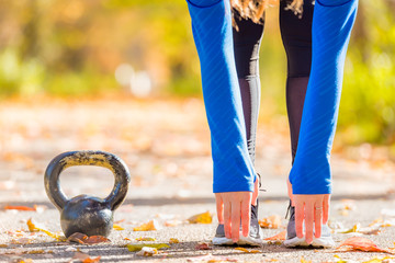 Woman outside with kettlebell
