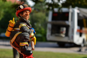 toy of fireman on background fire engine