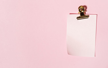 sticky note on pink background