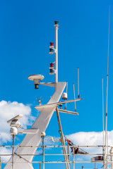 View of the yacht masthead against the blue sky, Sete, France. Close-up. Vertical