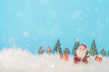 Christmas holiday background with Santa and decorations. Christmas landscape with gifts and snow. Merry christmas and happy new year greeting card with copy space.