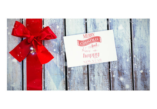 Holiday Card Mockup with Red Ribbon on Wooden Table