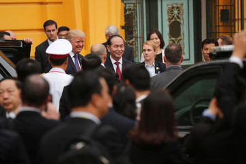U.S. President Donald Trump and Vietnam's President Tran Dai Quang participate in a welcome ceremony and official photo upon his arrival at the Presidential Palace in Hanoi