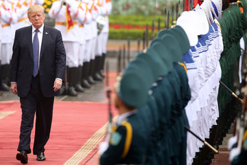 US President Donald J. Trump reviews the honor guard at the Presidential Palace in Hanoi, Vietnam