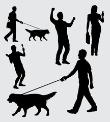 Walking with dog, male and female action silhouette. good use for symbol, logo, web icon, mascot, sticker, sign, or any design you want.