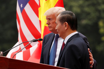 Vietnam's President Tran Dai Quang and U.S. President Donald Trump address a joint news conference at the Presidential Palace in Hanoi