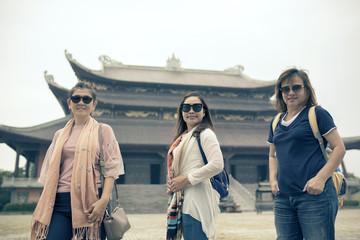 asian tourist taking group photograph in chu bai dinh  temple ninh binh province vietnam