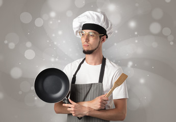 Male cook with shiny grey wallpaper