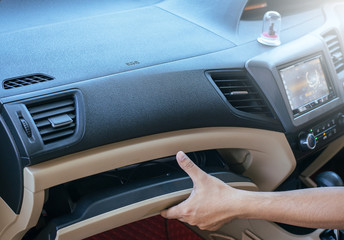 Hand open glove compartment box in car Wall mural