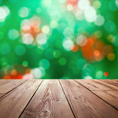 Christmas holiday background with rustic table top over christmas bokeh for product display