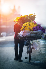 domiestic life photography of vietnamese woman and selling flower bicycle in hanoi city