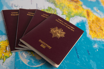 French passports on map and plane background