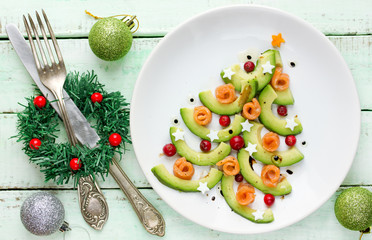 Avocado salmon salad shaped Christmas tree