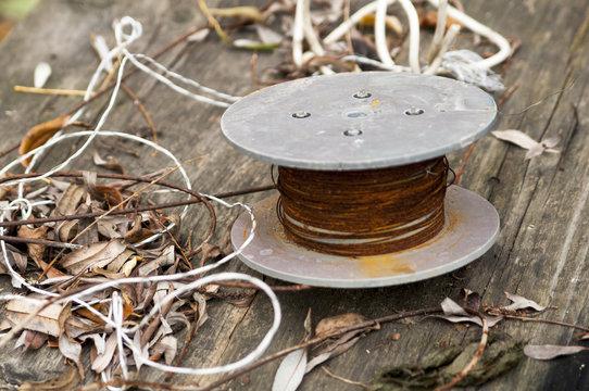 wire gauge on wooden background