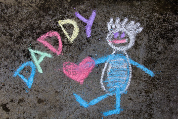 chalk drawing on asphalt: Cute father portrait and word DADDY