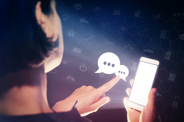 Image of a girl with a smartphone in hands. She presses on the speech bubbles icon.  Communication and technology concept. Corporate chat, feedback, support service.