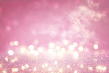 Pink glitter vintage lights background. de focused.
