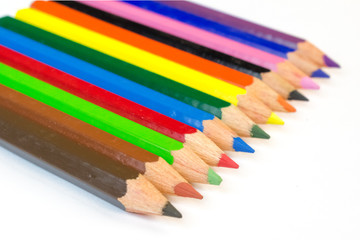 Colorful pencils arranged in a line