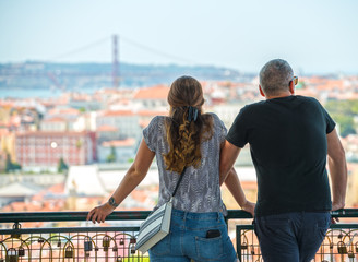 Pair of tourists in the background of Lisbon.
