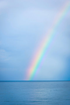 Rainbow over the blue water