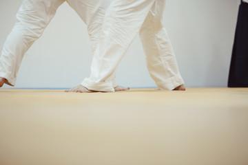 feet on the Mat in battle